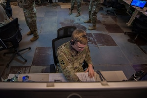 U.S. Army 1st Lt. Andrew Plautz, 11th Air Defense Artillery (ADA) Brigade ADA fire control officer, monitors information during Air Missile and Defense Exercise (AMDEX) 21-1 at Al Dhafra Air Base, United Arab Emirates, Oct. 23, 2020.