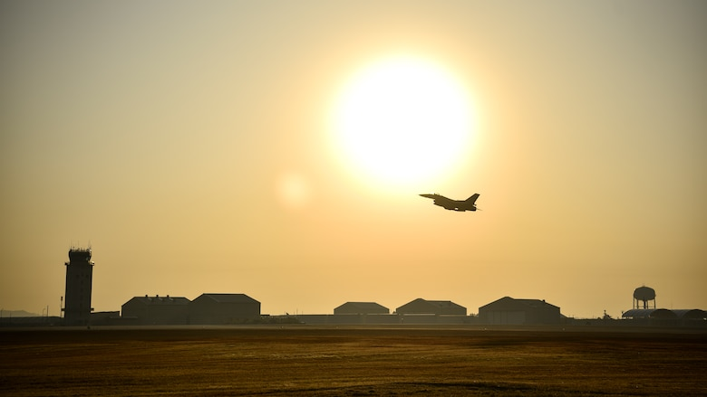 A photo of a fighter jet taking off.