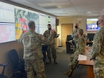 U.S. Army Brig. Gen. Laura Clellan, U.S. Army Brig. Gen. Scott M. Sherman, Lt. Col. Michael J Bruno and other leaders conduct a wildfire situation brief in the Joint Operations Center, Centennial, Colo., Oct 22, 2020. The team was reviewing fire development throughout Colorado.