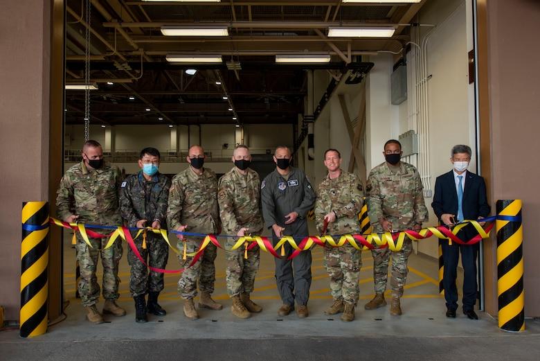 Air Force members prepare to cut a ribbon