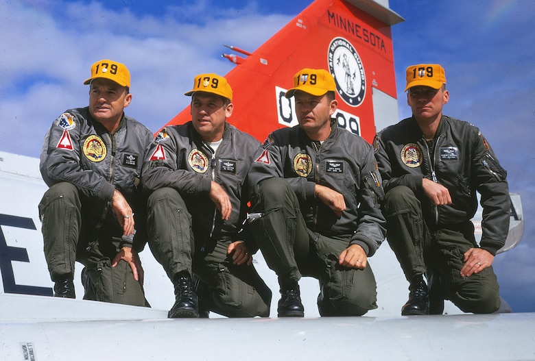 "Pictured left to right:  Lt. Col. Al ""Ammo"" Amatuzio, Maj. Ray ""Raycee"" Sahlstrom, Capt. John ""Rev"" Broman and Capt. Ray ""Klos"" Klosowski pose for a photo on a F-102 Deuce assigned to the 148th Fighter Group during the William Tell gunnery competition at Tyndall Air Force Base, Florida in October 1970."