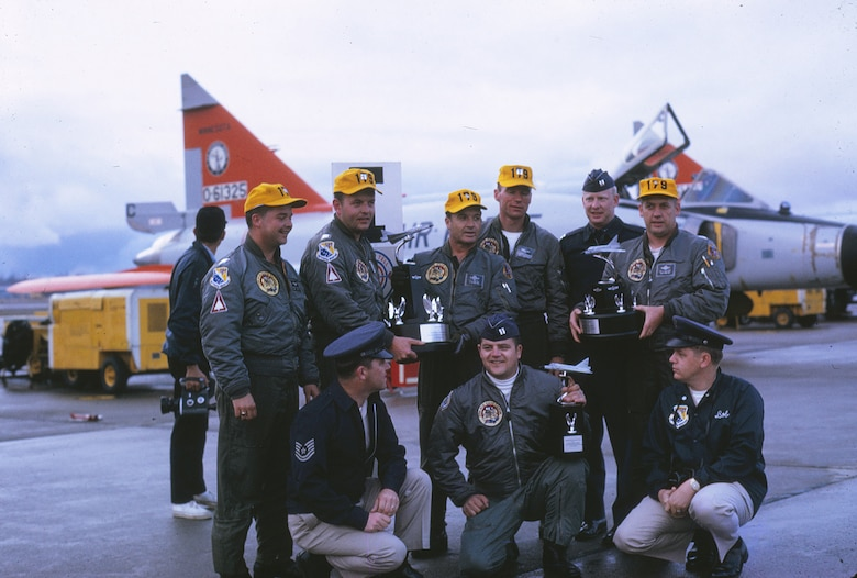 Pilots, weapons controllers and aircraft maintenance personnel pose for a photo with the three trophies presented to the 148th Fighter Group at the 1970 William Tell gunnery competition at Tyndall Air Force Base, Florida.