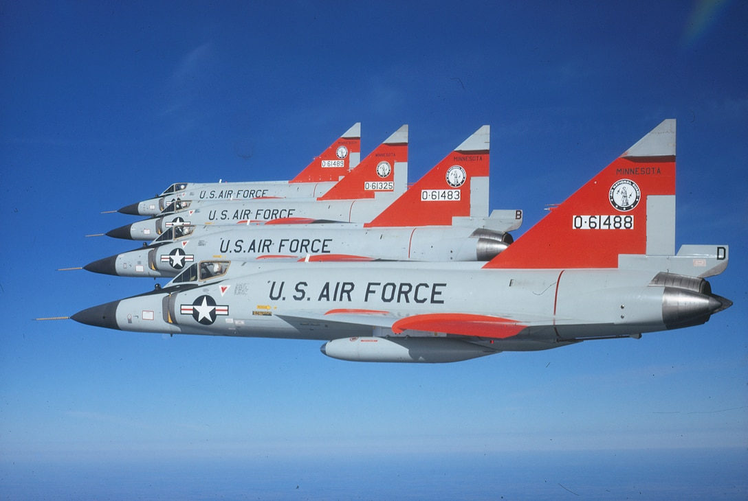 """Four F-102 """"Deuces"""" that flew in the 1970 William Tell gunnery competition at Tyndall Air Force Base, Florida fly in formation."""