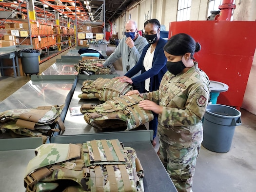 Dr. Daniel Mountjoy (left), Christine Villa, and Maj. Saily Rodriguez, with the Air Force Life Cycle Management Center's Human Systems Division, perform an inspection on new body armor units designed specifically for female Airmen in Security Forces.  (U.S. Air Force photo / Brian Brackens)