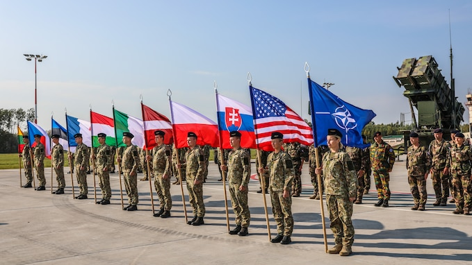 Soldiers from ten nations prepare static displays for closing ceremony of Tobruq Legacy 2020 at Siauliai Air Base, Lithuania. Tobruq Legacy is a biennial air defense exercise that looks to advance the capabilities of the US and its NATO Allies and partners in Eastern Europe, to train more cohesively and to enhance a unified command. Approximately 750 military personnel from 10 ally nations including Czech Republic, Estonia, France, Hungary, Italy, Latvia, Lithuania, Poland, and the United States participated in this exercise.