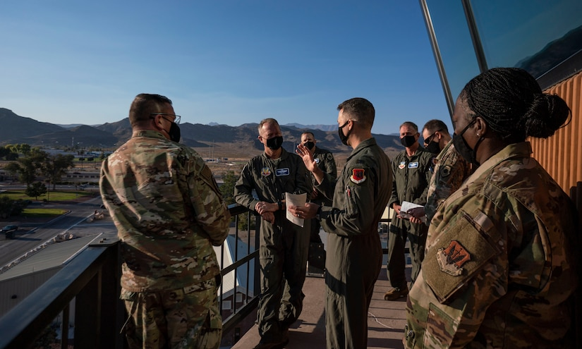 Col. Stephen Jones, 432nd Wing/432nd Air Expeditionary Wing commander, gives a canvas tour of the installation to Gen. Mark Kelly, from the top of the air traffic control tower.