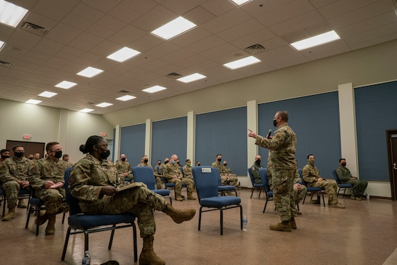 Chief Master Sgt. David Wade, command chief of Air Combat Command, speaks to enlisted members during an enlisted call in the base auditorium.