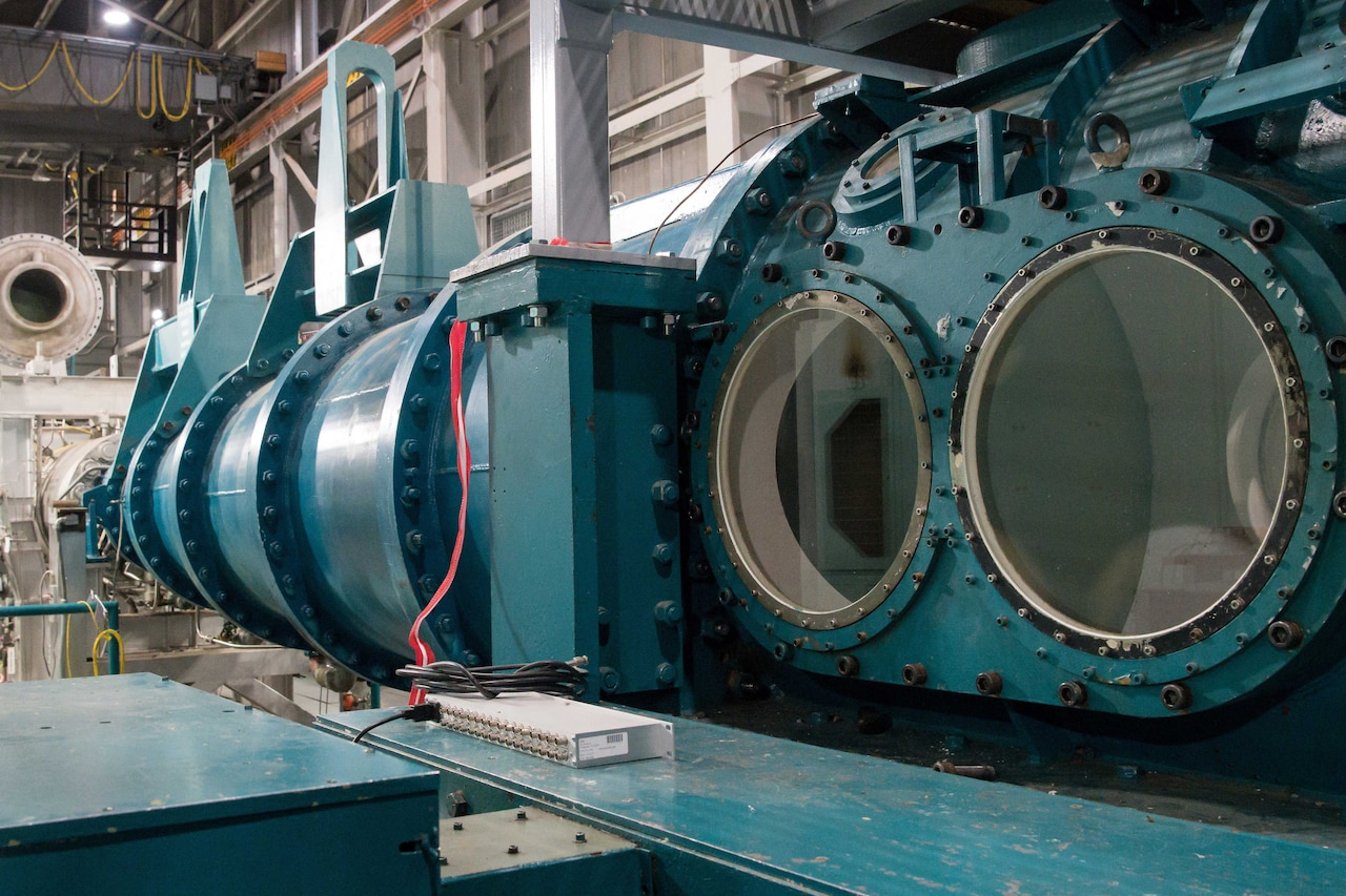 A photograph shows a large piece of machinery inside a building.