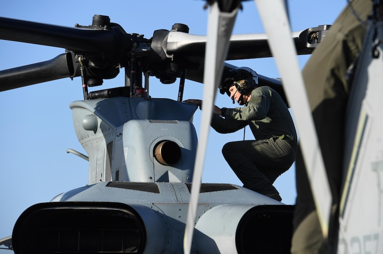 U.S. Marine Corps Capt. Edward Ross, Marine Light Attack Helicopter Squadron 167 AH-1Z Cobra pilot, Marine Corps Air Station New River, North Carolina, conducts a pre-flight inspection on an AH-1Z Cobra at Keesler Air Force Base, Mississippi, Oct. 21, 2020. Two AH-1Z Cobras and two UH-1Y Hueys were at Keesler for joint training with the Marine Special Operations Command during their RAVEN exercise from Oct. 12-21. RAVEN is the exercise Marine Raiders complete after their six-month training cycle in preparation for deployment to ensure operational readiness of the Marine Special Operations Teams. (U.S. Air Force photo by Kemberly Groue)