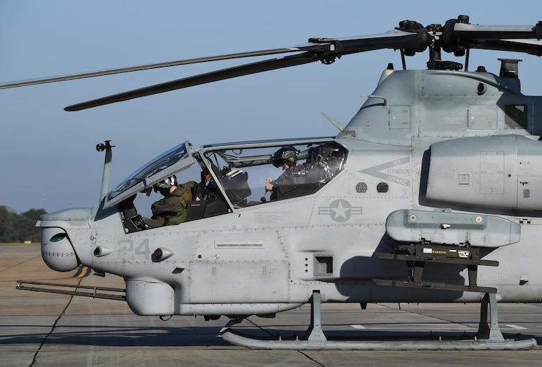 U.S. Marine Corps Capts. Edward Ross and Jeffrey Jaeckel, Marine Light Attack Helicopter Squadron 167 AH-1Z Cobra pilots, Marine Corps Air Station New River, North Carolina, prepare to fly an AH-1Z Cobra at Keesler Air Force Base, Mississippi, Oct. 21, 2020. Two AH-1Z Cobras and two UH-1Y Hueys were at Keesler for joint training with the Marine Special Operations Command during their RAVEN exercise from Oct. 12-21. RAVEN is the exercise Marine Raiders complete after their six-month training cycle in preparation for deployment to ensure operational readiness of the Marine Special Operations Teams. (U.S. Air Force photo by Kemberly Groue)