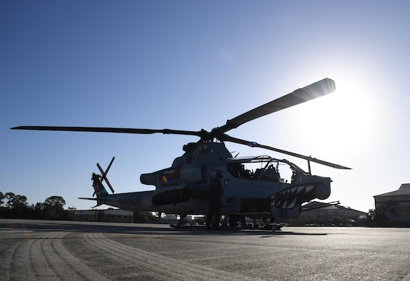 An AH-1Z Cobra from the Marine Light Attack Helicopter Squadron 167, Marine Corps Air Station New River, North Carolina, is on displayed on the flightline at Keesler Air Force Base, Mississippi, Oct. 21, 2020. Two AH-1Z Cobras and two UH-1Y Hueys were at Keesler for joint training with the Marine Special Operations Command during their RAVEN exercise from Oct. 12-21. RAVEN is the exercise Marine Raiders complete after their six-month training cycle in preparation for deployment to ensure operational readiness of the Marine Special Operations Teams. (U.S. Air Force photo by Kemberly Groue)