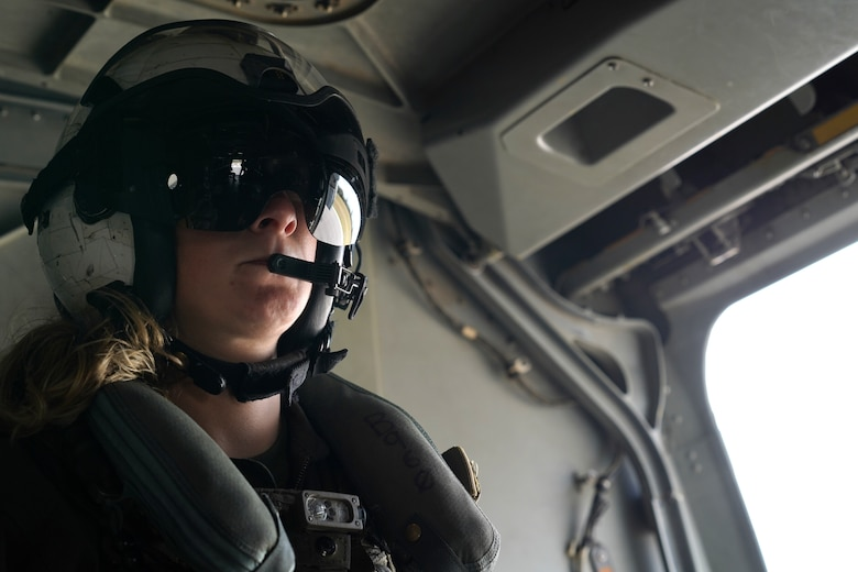 U.S. Marine Corps Sgt. Stephanie Fregoe, VMM-774 MV-22B Osprey crew chief, Naval Air Station Norfolk, Virginia, rides in an Osprey flying over Gulfport, Mississippi, Oct. 23, 2020. Marines came to Keesler to conduct routine training operations in and around the Mississippi area. (U.S. Air Force photo by Airman 1st Class Seth Haddix)