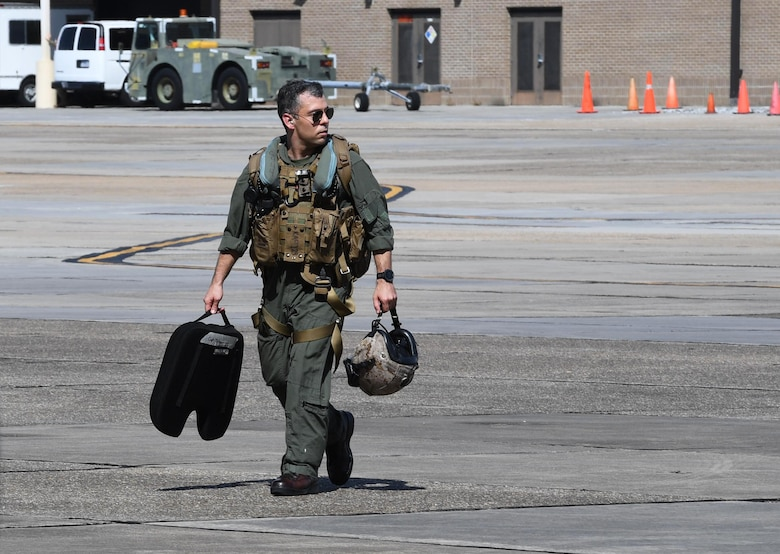 U.S. Marine Corps Maj. Patrick Testa, Marine Medium Tiltrotor Squadron 774 pilot, Naval Air Station Norfolk, Virginia, walks off the flightline after piloting a MV-22B Osprey at Keesler Air Force Base, Mississippi, Oct. 23, 2020. Marines came to Keesler to conduct routine training operations in and around the Mississippi area. (U.S. Air Force photo by Kemberly Groue)