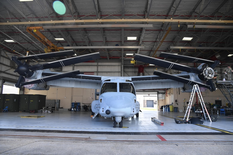 A MV-22B Osprey from the Marine Medium Tiltrotor Squadron 774, Naval Air Station Norfolk, Virginia, receives routine maintenance inside a hangar at Keesler Air Force Base, Mississippi, Oct. 23, 2020. Marines came to Keesler to conduct routine training operations in and around the Mississippi area. (U.S. Air Force photo by Kemberly Groue)
