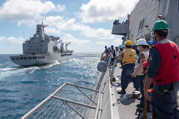 The Independence-variant littoral combat ship USS Gabrielle Giffords (LCS 10) conducts a replenishment-at-sea (RAS) with the Chilean navy replenishment oiler CNS Almirante Montt (AO-52).