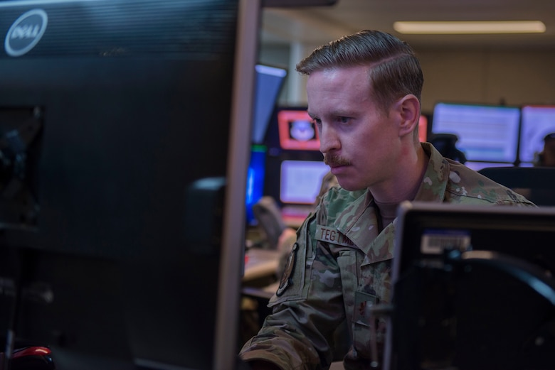 """U.S. Air Force Maj. Christopher Tegmeyer, 727th Expeditionary Air Control Squadron, also known as """"Kingpin,"""" mission commander, monitors information during Air Missile and Defense Exercise (AMDEX) 21-1 at Al Dhafra Air Base, United Arab Emirates, Oct. 23, 2020."""