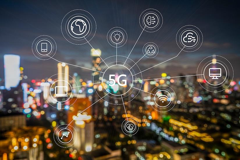 5G icon web chart over a cityscape.