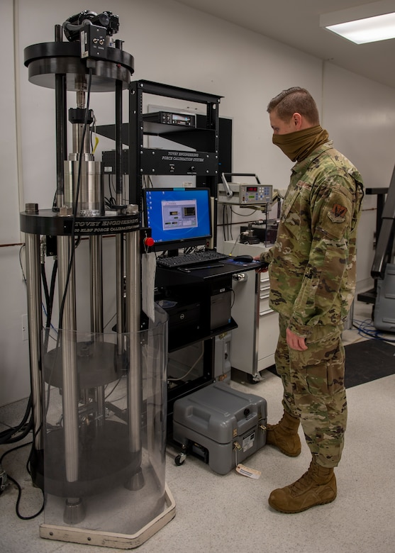 Staff Sgt. Jacob Felton, 4th Component Maintenance Squadron physical dimensional supervisor, uses a tension force gauge to tests a strain gauge at Seymour Johnson Air Force Base, North Carolina, Oct. 19, 2020.