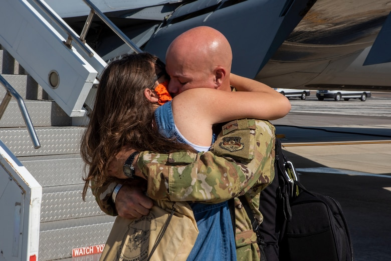 U.S Air Force Lt. Col. Ricardo Lopez, the 50th Air Refueling Squadron inspector general, hugs a family membet at MacDill Air Force Base, Florida, Oct. 18, 2020, from a two-month deployment at Al Udeid Air Base, Qatar.