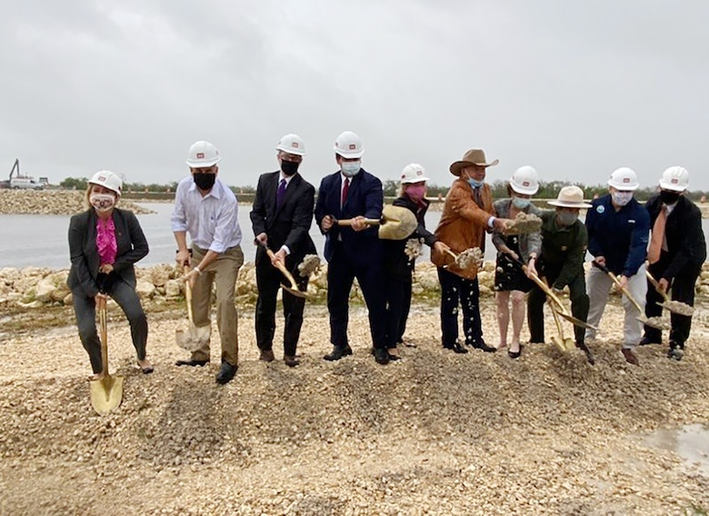 Federal and state partners shovel ceremonial sand to kick-off the official start of the Jacksonville District's Central Everglades Planning Project South at a groundbreaking ceremony.in Miami today. (USACE photo by Mark Rankin)