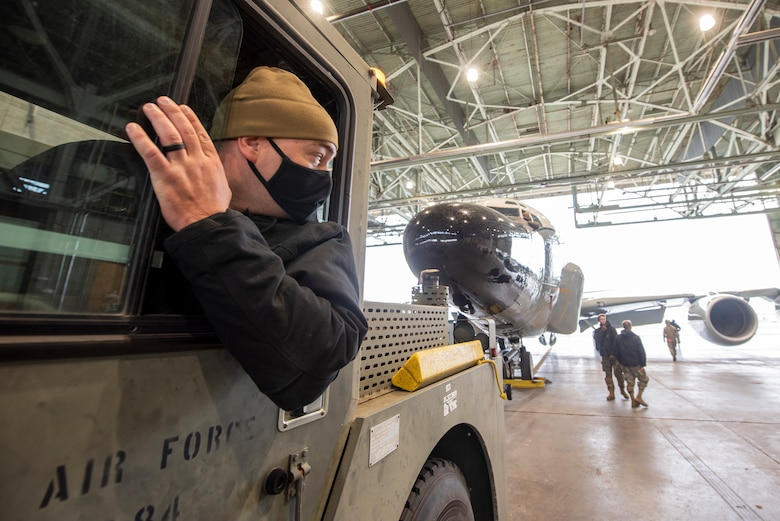 An Airman tows an aircraft into the North Hangar at Lincoln Airport during a proof of concept exercise Oct. 23, 2020.
