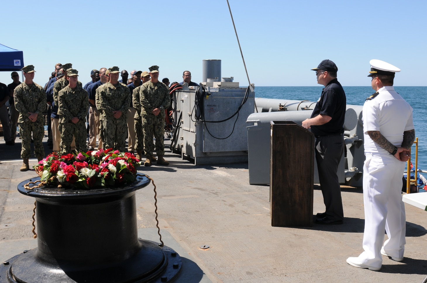 Retired Rear Admiral Samuel Cox, Director, Naval History and Heritage Command, speaks to Sailors aboard the USNS Grasp (T-ARS-51) during a wreath-laying ceremony to commemorate the 100th anniversary of the sinking of the USS San Diego (ACR 6). Believed to be caused by a German mine or torpedo, the armored cruiser sank in 28 minutes with the loss of six lives. The ceremony was organized by the Naval History and Heritage Command, which is responsible for the preservation, analysis, and dissemination of U.S. Naval history and heritage.