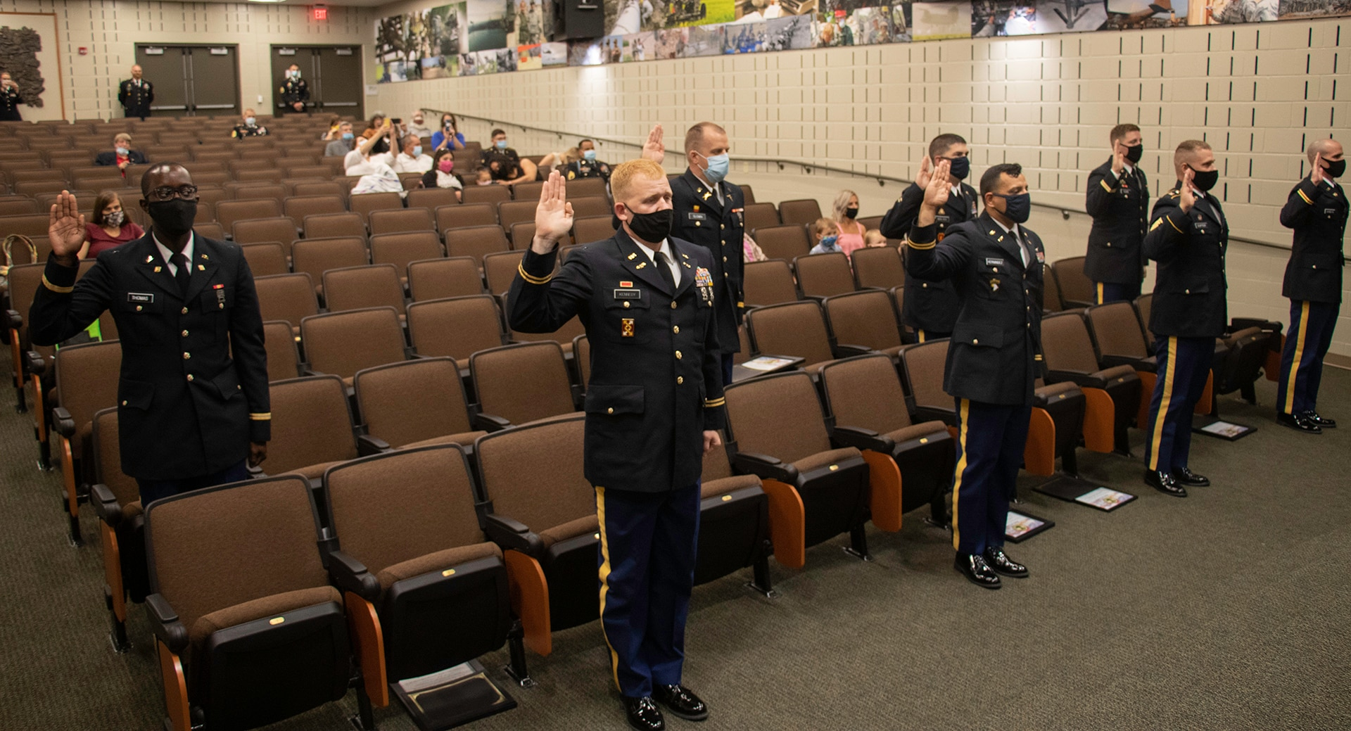 The 2020 graduates of the Illinois Army National Guard's Officer Candidate School recite the oath of office during the OCS Commissioning ceremony Aug. 23 at the Illinois Military Academy, Camp Lincoln, Springfield, Illinois.