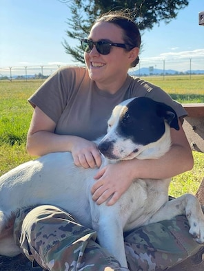 Puppy Rescue Mission uses social media platforms to support and receive donations for future pets like Carl and others. These deployers express emotion they feel for this canines who are about to be adopted. (Courtesy photo by PRM Facebook page).