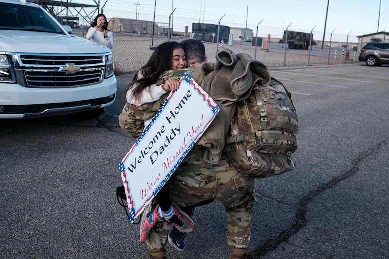 An Airman assigned to the 729th Air Control Squadron hugs a family member upon his return home.