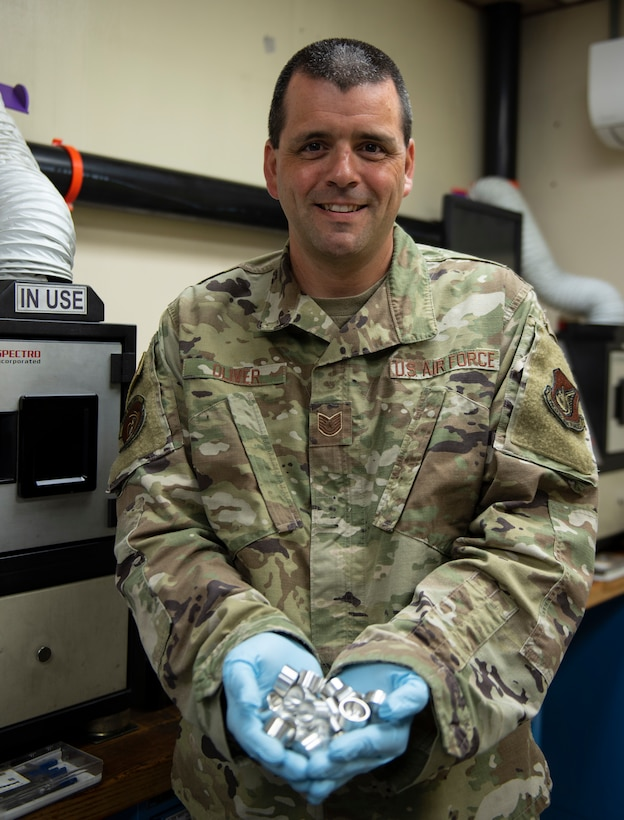Tech. Sgt. Patrick Oliver, noncommissioned officer in charge of non-destructive inspections assigned to the 36th Maintenance Squadron holds his prototypes Oct. 22, 2020, at Andersen Air Force Base, Guam.