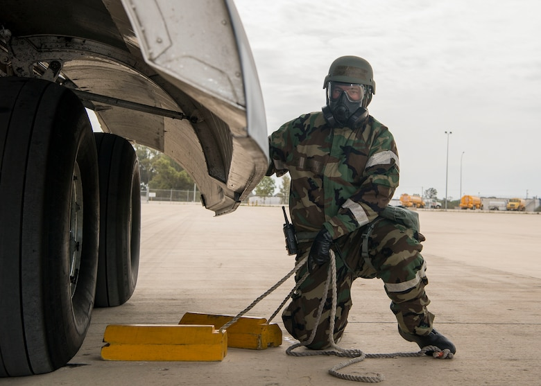 U.S. Air Force Staff Sgt. Jarom Johnston, attached to the 521st Air Mobility Squadron pulls blocks from U.S. Air Force C-17 Globemaster III wheels during exercise Nodal Lightning 20-2.