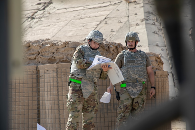 U.S. Air Force Staff Sgt. Karissa Kayfes, 5th Expeditionary Aircraft Maintenance Squadron supply airman, and Master Sgt. Kris Savell, 5th EAMS production superintendent, conduct a post-attack reconnaissance sweep during Exercise Nodal Lightning 20-2.
