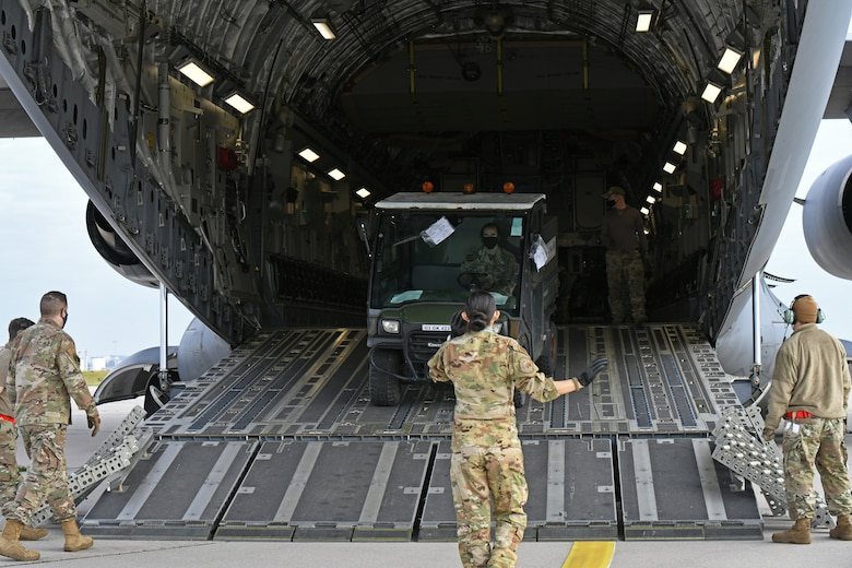 U.S. Air Force Airmen assigned to the 721st Air Mobility Operations Group, Ramstein Air Base, Germany, load a vehicle on to a U.S. Air Force C-17 Globemaster III aircraft during a multi-capable Airmen lift-and-shift training exercise, Nodal Lightning 20-2.