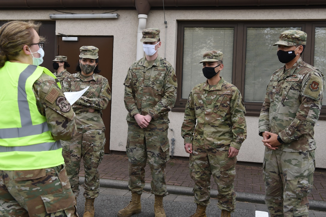 Ramstein Airmen receive a pre-screening brief prior to entering Hangar 3 for their flu vaccine at Ramstein Air Base, Germany, Oct. 27, 2020.