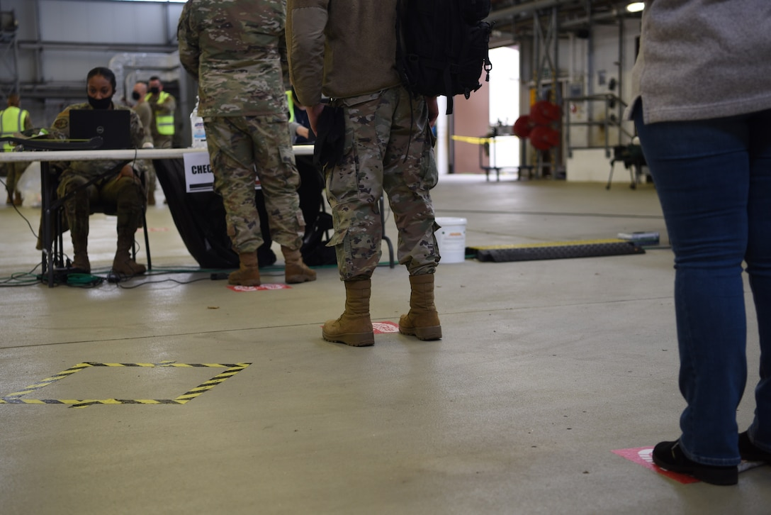 Ramstein Airmen maintain appropriate physical distance during check-in for their flu vaccine at Ramstein Air Base, Germany, Oct. 27, 2020.