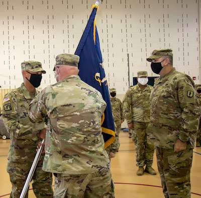 Col. Daniel Reichen, of Springfield, Illinois, receives the 129th Regiment (Regional Training Institute) colors from Maj. Gen. Michael Zerbonia, of Chatham, Illinois, Assistant Adjutant General – Army and Commander, Illinois Army National Guard, during the 129th's change of command ceremony Aug. 23 at the Illinois Military Academy, Camp Lincoln, Springfield, Illinois.