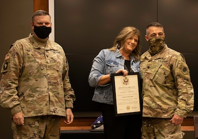 Angie Jiannoni, wife of Lt. Col. Jeffary Jiannoni, of Petersburg, Illinois, accepts a Certificate of Appreciation from Col. Leonard Williams, of Dyer, Indiana, Chief of Staff, Illinois Army National Guard, during Jiannoni's retirement ceremony Oct. 8 at the Illinois Military Academy, Camp Lincoln, Springfield, Illinois.