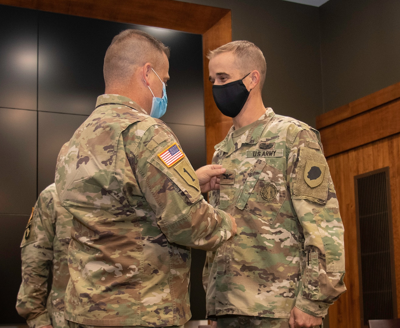 Newly promoted Col. Kevin G. Little's brother, Brig. Gen. Eric Little, Vice Director, National Guard Bureau Force Structure, Resources and Assessment (J-8), places his new rank