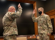 Newly promoted Col. Kevin G. Little, of Franklin, Illinois, recites the oath of commissioned officers