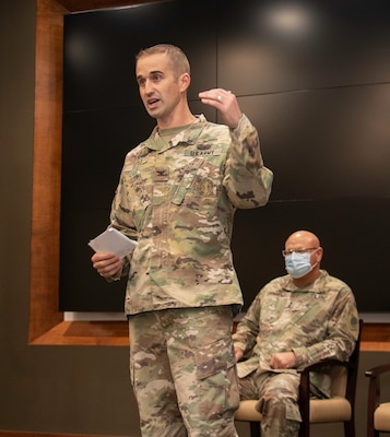 Newly promoted Col. Kevin G. Little, of Franklin, Illinois, addresses friends and family during his promotion ceremony at the Illinois Military Academy, Camp Lincoln, Springfield, Illinois Oct. 15.