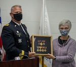 Kathy Andersen, of Roscoe, Illinois, great niece of the late Homer Stanger, accepts Stanger's returned medals from Brig. Gen. Mark Jackson, of Frankfort, Illinois, Director, Joint Staff, Illinois National Guard, during a brief ceremony Oct. 20 at the Illinois Army National Guard armory in Machesney Park, Illinois. Stanger's medals were located in the Wise County Sheriff's Department evidence locker in Decatur, Texas and sent to the Illinois National Guard for the presentation.