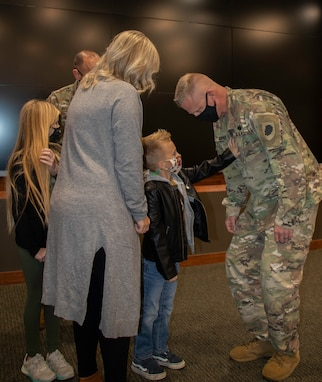 Illinois Army National Guard Master Sgt. Clint Murphy, of Athens, Illinois, receives his First Sergeant rank from son, Van, daughter, Dylan, and wife, Jessica, during a pinning ceremony Oct. 23 at the Illinois Military Academy, Camp Lincoln, Springfield, Illinois