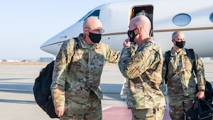 Gen. Arnold W. Bunch, Jr., commander of Air Force Materiel Command, converses with Maj. Gen. Christopher Azzano, Air Force Test Center commander, as he arrives at Edwards Air Force Base, California, Oct. 23. (Air Force photo by Giancarlo Casem)