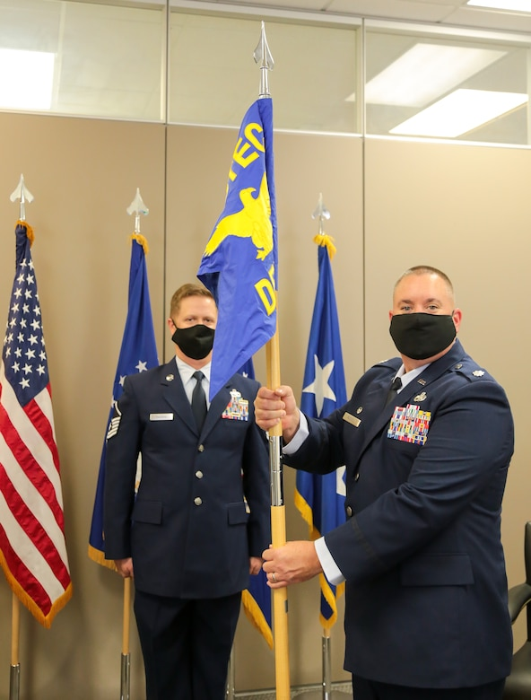 Lt. Col. Jeremy Russell holds the Air Force Operational Test and Evaluation Center Detachment 3 guidon.
