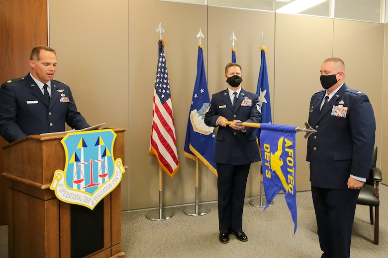 The Air Force Operational Test and Evaluation Center Detachment 3 guidon is presented.
