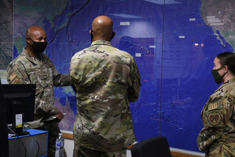 U.S Air Force Chief of Staff Gen. Charles Q. Brown, Jr., receives a briefing from Col. Omar Colbert, 576th Flight Test Squadron commander, and Capt. Morgan Pack, 576th FLTS intercontinental ballistic missile test operator, during a tour Oct. 27, 2020, at Vandenberg Air Force Base, Calif.