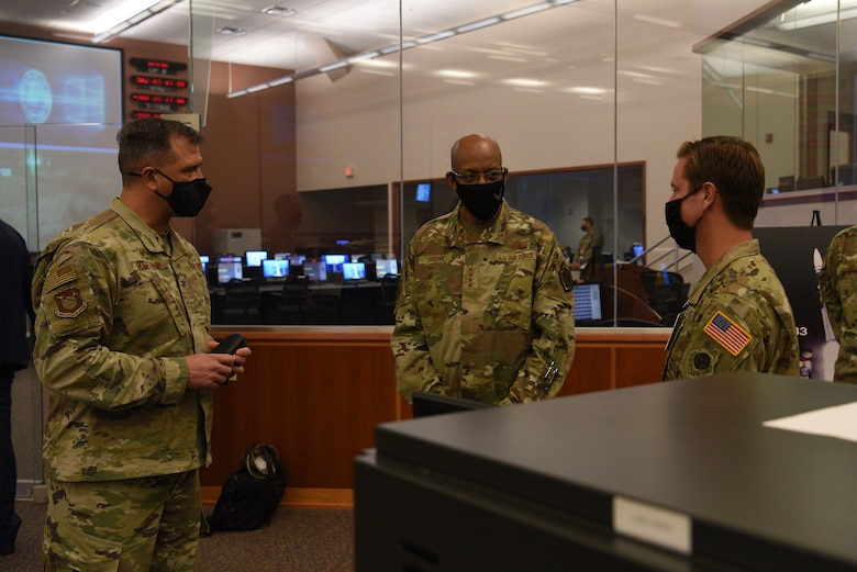 U.S Air Force Chief of Staff Gen. Charles Q. Brown, Jr., speaks with Col. Anthony Mastalir, 30th Space Wing commander, and Lt. Col. Sean Ianacone, 2nd Range Operations Squadron commander, during a tour of the Western Range Operations Control Center Oct. 27, 2020, at Vandenberg Air Force Base, Calif.