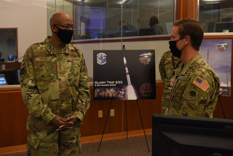 U.S Air Force Chief of Staff Gen. Charles Q. Brown, Jr., speaks with Lt. Col. Sean Ianacone, 2nd Range Operations Squadron commander, while visiting the Western Range Operations Control Center Oct. 27, 2020, at Vandenberg Air Force Base, Calif.