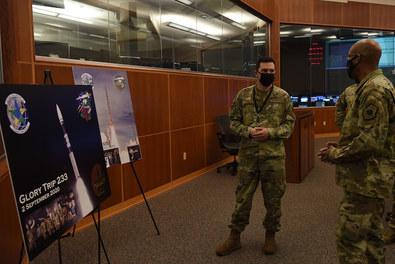 U.S Air Force Chief of Staff Gen. Charles Q. Brown, Jr., speaks with Capt. Adrian Catarius, 2nd Range Operations Squadron director of engineering, while touring the Western Range Operations Control Center Oct. 27, 2020, at Vandenberg Air Force Base, Calif.