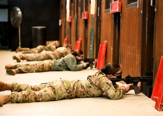 University of North Dakota Army Reserve Officer Training Corps cadets fire M4A1 carbines from the prone supported position during weapons familiarization training on Grand Forks Air Force Base, N.D., Oct. 24, 2020. The 319th Security Forces Squadron provided a full day of range access for the cadets to complete weapons training in order to maintain their annual training requirement. (U.S. Air Force photo by Staff Sgt. Patrick A. Wyatt)